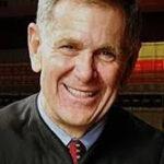 A headshot of Judge David Carter