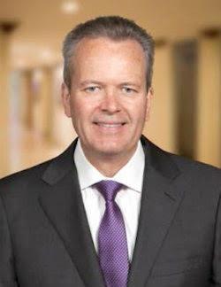 A headshot of Tim Busch