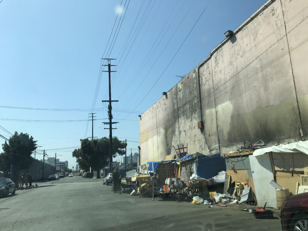 A row of homeless people's tents along Paloma Street as of May 5, 2021